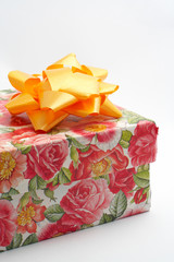 gift box with yellow ribbon, detail on white backg