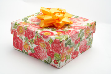 gift box with yellow ribbon, on white background