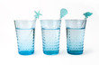 three glasses of mineral water with straw
