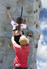 young woman on rock wall