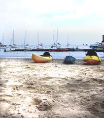 kayaks on a shady beach, isthmus, catalina island