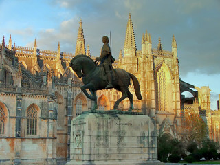 statue next to the monastery of batalha (portugal)