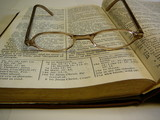 study bible and eye glasses poster