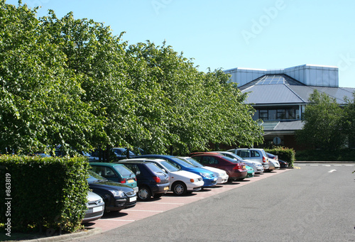 Leinwanddruck Bild parking lot and lowrise office