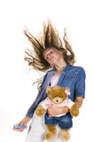 young girl dancing with teddy bear and mp3 player poster