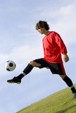 soccer - football player juggling in red poster