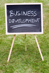 business development written on a chalkboard