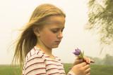 girl taking spring flower poster