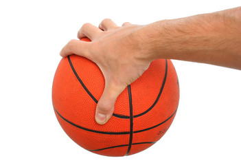 hand holding a basketball ball isolated