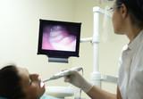 at the dentist -  teeth at the screen poster