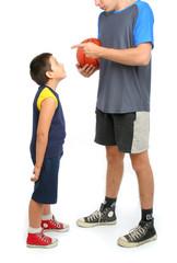 little boy asking big man to play basketball