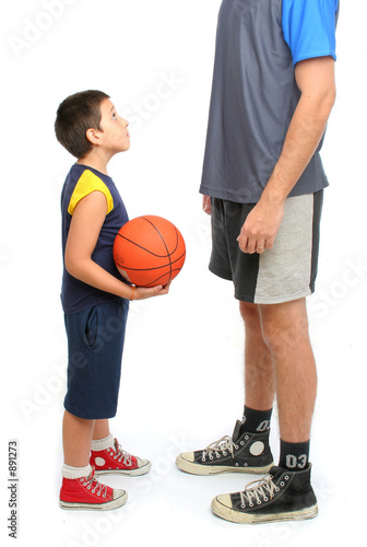 Poster little boy asking big man to play basketball