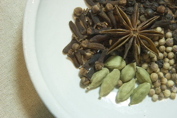 bowl of spices with star anise