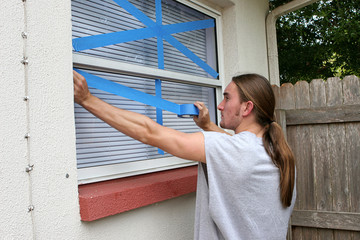 teen taping windows h