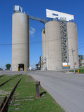 silos of a cement plant poster