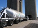 truck loading at ready mix cement plant poster
