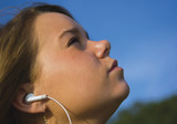 pretty teenage girl listening to portable music player poster