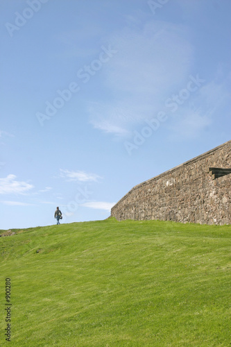 woman walking on grass bank stirling castle in sco
