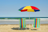 beach chairs and umbrella poster