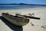 polynesian canoe on beach