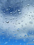 drop of rain on background blue sky poster