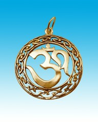 gold amulet on heavens background.