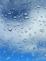 drop of rain on background blue sky