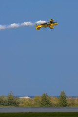 bulldog stunt biplane in a low inverted pass