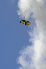 bulldog stunt biplane coming out of a vertical loo