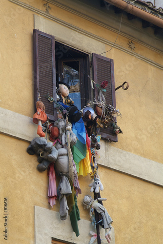 soft-toys hanging out of a window