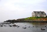 house on ocean shore poster