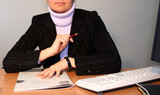 businesswoman working at his desk poster