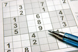 sudoku puzzle & pen poster