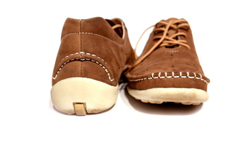 a pair of brown shoes.isolated on white