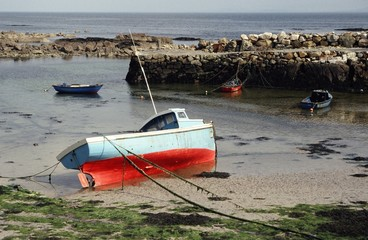 irish fishing boats at low tide