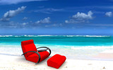 red sofa on beach poster