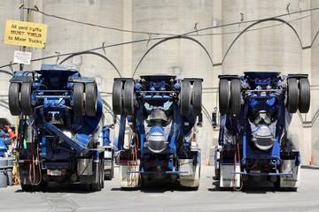 three mixer trucks
