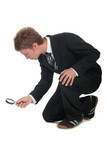 businessman with magnifying glass poster