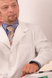 doctor holding eyeglasses poster