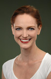 portrait of redheaded woman smiling poster