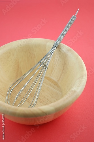 wire whisk in wooden  bowl