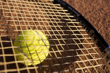 a racket and a tennis ball