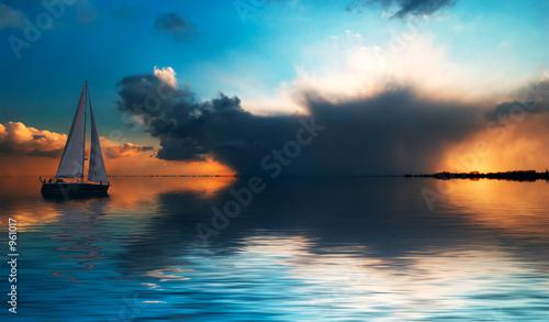 Leinwandbild Motiv sailing at sunset