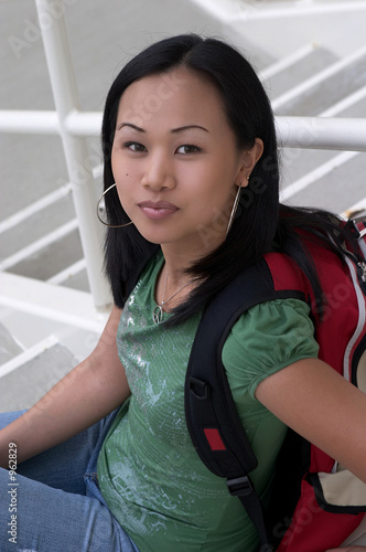 asian student with backpack on steps