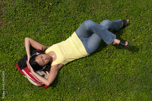 young student resting on backpack