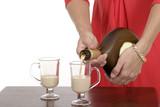 close-up of woman pouring irish creme liqueur 1 poster