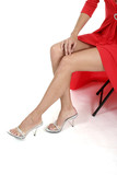 beautiful legs of woman in red dress poster