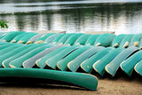 canoes on lake shore poster