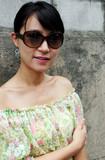 asian woman wearing big shades poster
