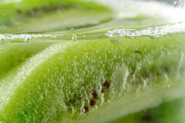 piece of kiwi fruit with bubbles